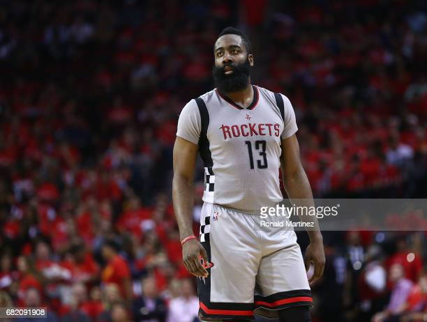 James Harden of the Houston Rockets looks on against the San Antonio Spurs during Game Six of the NBA Western Conference SemiFinals at Toyota Center...