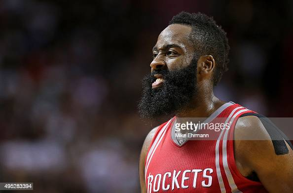 James Harden of the Houston Rockets looks on during a game against the Miami Heat at American Airlines Arena on November 1 2015 in Miami Florida NOTE...