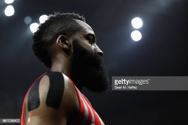 James Harden of the Houston Rockets looks on during the first half of a game against the LA Clippers at Staples Center on April 10 2017 in Los...