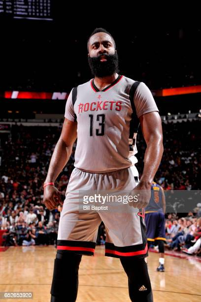 James Harden of the Houston Rockets looks on during the game against the Cleveland Cavaliers on March 12 2017 at the Toyota Center in Houston Texas...