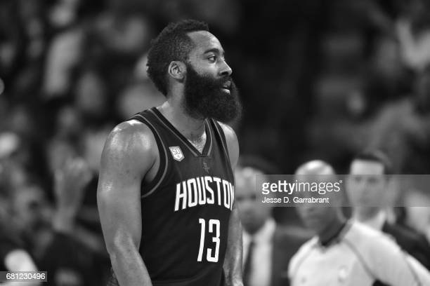 James Harden of the Houston Rockets looks on during the game against the San Antonio Spurs during Game Five of the Western Conference Semifinals of...