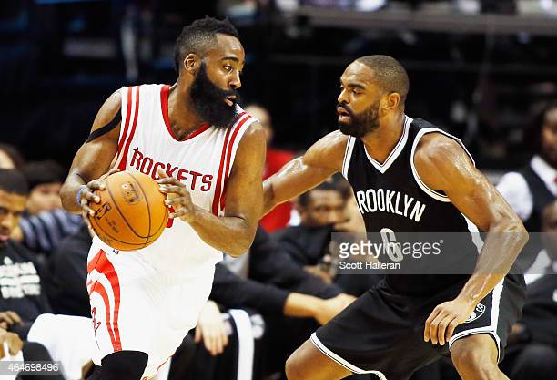 James Harden of the Houston Rockets looks to drive against Alan Anderson of the Brooklyn Nets during their game at the Toyota Center on February 27...