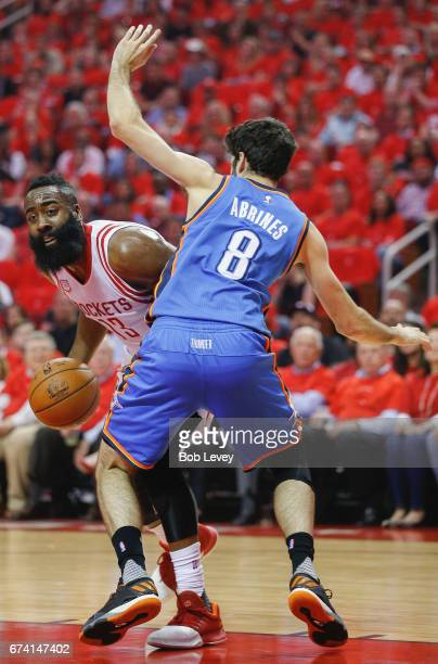 James Harden of the Houston Rockets looks to drive around Alex Abrades of the Oklahoma City Thunder during Game Five of the Western Conference...
