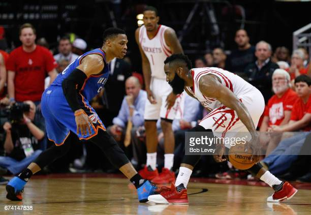 James Harden of the Houston Rockets looks to drive on Russell Westbrook of the Oklahoma City Thunder during Game Five of the Western Conference...
