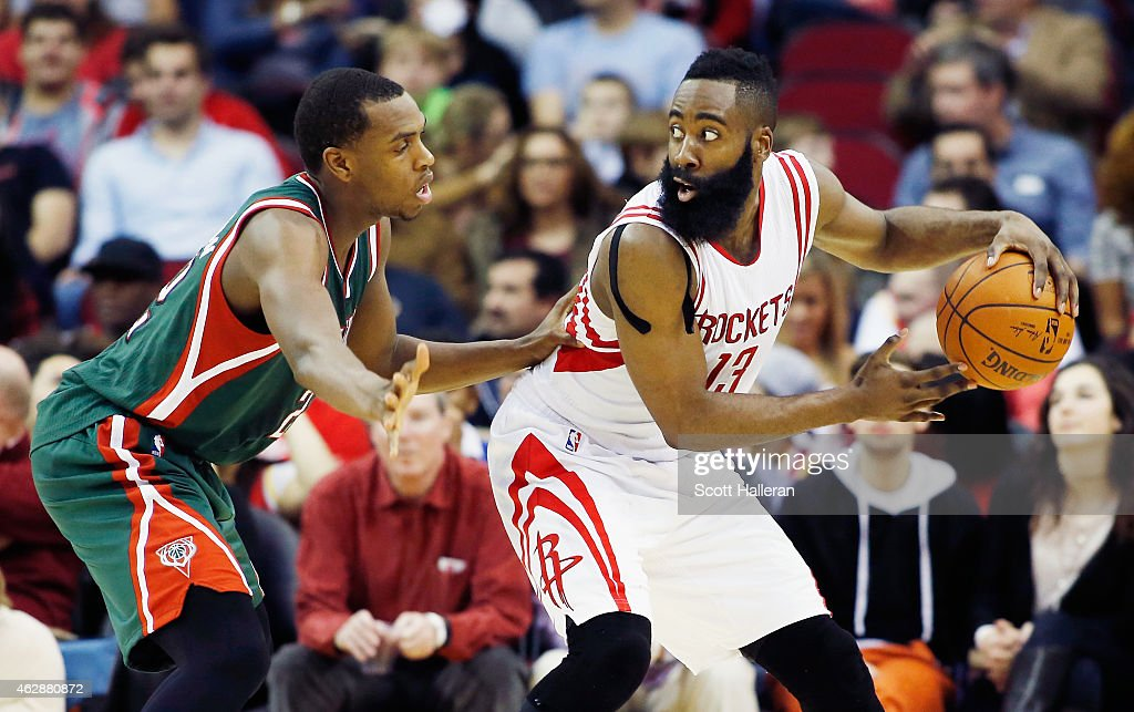 James Harden #13 of the Houston Rockets looks to drive with the basketball as Khris Middleton #22 of the Milwaukee Bucks defends during their game at the Toyota Center on February 6, 2015 in Houston, Texas.