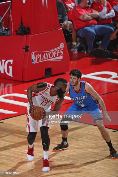 James Harden of the Houston Rockets looks to make a move against Alex Abrines of the Oklahoma City Thunder in Game Five of the Western Conference...