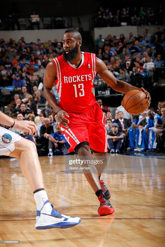 James Harden #13 of the Houston Rockets looks to pass the ball against the Dallas Mavericks on January 16, 2013 at the American Airlines Center in Dallas, Texas.