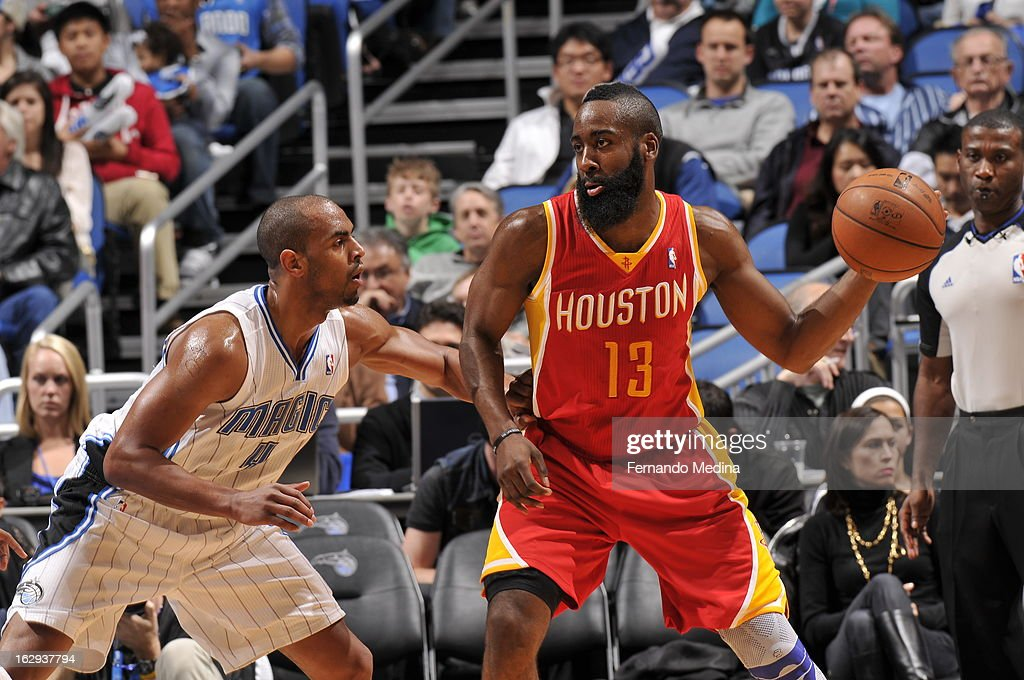 James Harden #13 of the Houston Rockets looks to pass the ball against Arron Afflalo #4 of the Orlando Magic during the game on March 1, 2013 at Amway Center in Orlando, Florida.