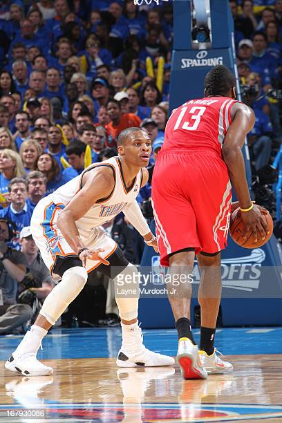 James Harden of the Houston Rockets looks to pass the ball while guarded by Russell Westbrook of the Oklahoma City Thunder in Game Two of the Western...