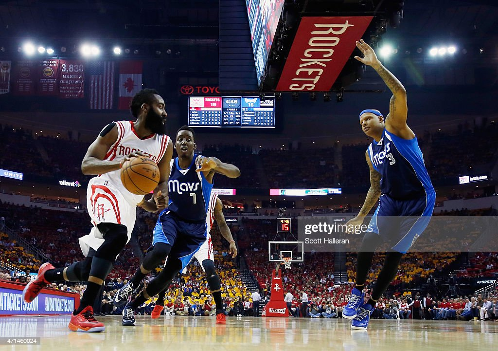 James Harden #13 of the Houston Rockets looks to pass the basketball in front of Al-Farouq Aminu #7 and Charlie Villanueva #3 of the Dallas Mavericks of the Dallas Mavericks during Game Five in the Western Conference Quarterfinals of the 2015 NBA Playoffs on April 28, 2015 at the Toyota Center in Houston, Texas.