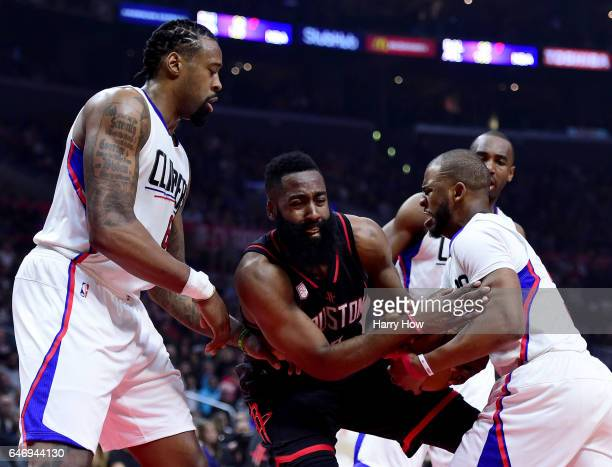 James Harden of the Houston Rockets loses the ball to Chris Paul of the LA Clippers as DeAndre Jordan looks on during the first half at Staples...