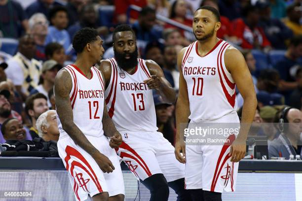 James Harden of the Houston Rockets Lou Williams and Eric Gordon talk during a game against the New Orleans Pelicans at the Smoothie King Center on...