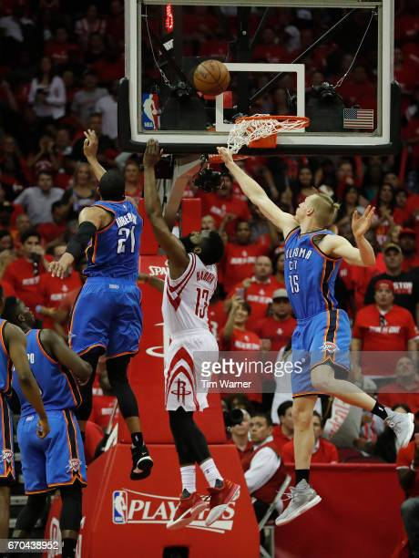 James Harden of the Houston Rockets makes a layup defended by Andre Roberson of the Oklahoma City Thunder and Kyle Singler in the second half of Game...