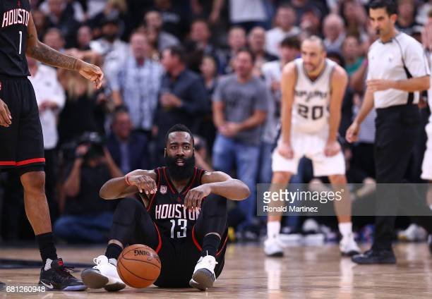James Harden of the Houston Rockets on the court after being fouled by Patty Mills of the San Antonio Spurs during Game Five of the Western...