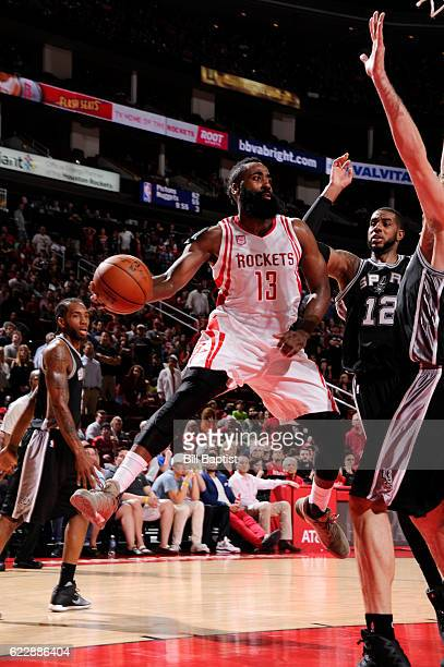 James Harden of the Houston Rockets passes the ball during a game against the San Antonio Spurs on November 12 2016 at the Toyota Center in Houston...