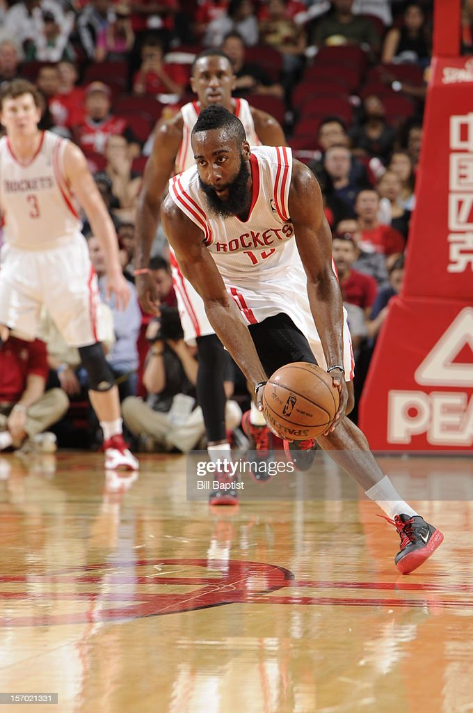 <a gi-track='captionPersonalityLinkClicked' href=/galleries/search?phrase=James+Harden&family=editorial&specificpeople=4215938 ng-click='$event.stopPropagation()'>James Harden</a> #13 of the Houston Rockets picks up a lose ball against the Chicago Bulls on November 21, 2012 at the Toyota Center in Houston, Texas.