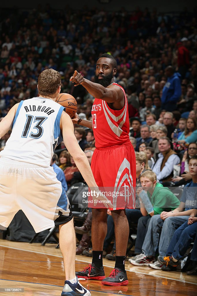 James Harden #13 of the Houston Rockets points to his teammate downlow while holding the ball against the Minnesota Timberwolves during the game on January 19, 2013 at Target Center in Minneapolis, Minnesota.