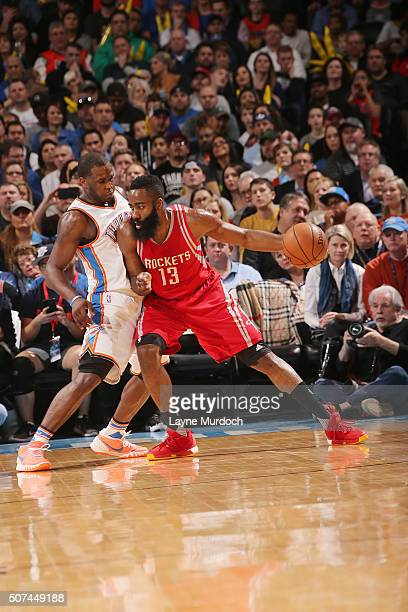 James Harden of the Houston Rockets posts up against Dion Waiters of the Oklahoma City Thunder on January 29 2016 at Chesapeake Energy Arena in...