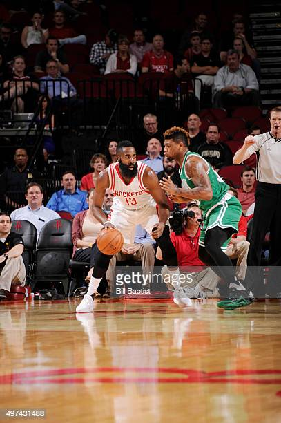 James Harden of the Houston Rockets posts up against Marcus Smart of the Boston Celtics on November 16 2015 at the Toyota Center in Houston Texas...