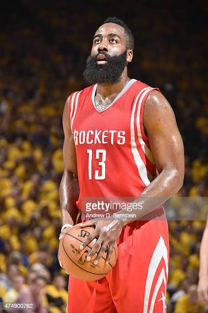 James Harden of the Houston Rockets prepares to shoot a free throw against the Golden State Warriors in Game Five of the Western Conference Finals...