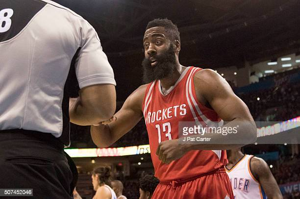 James Harden of the Houston Rockets protests a foul call to referee Marc Davis as he plays against the Oklahoma City Thunder during the first quarter...