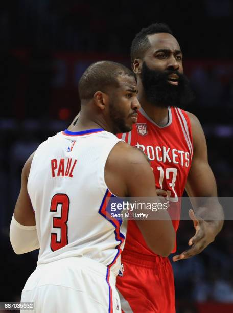 James Harden of the Houston Rockets pushes off of Chris Paul of the LA Clippers during the first half of a game at Staples Center on April 10 2017 in...