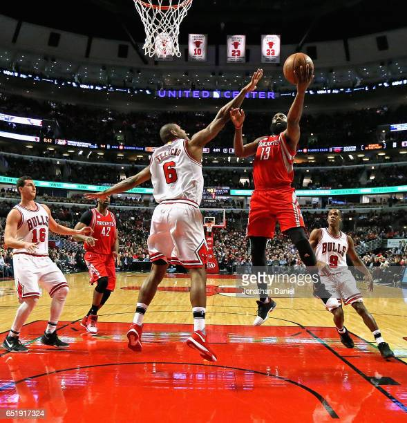 James Harden of the Houston Rockets puts up a shot over Cristiano Felicio of the Chicago Bulls at the United Center on March 10 2017 in Chicago...