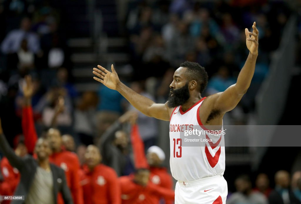James Harden #13 of the Houston Rockets reacts after a play against the Charlotte Hornets during their game at Spectrum Center on October 27, 2017 in Charlotte, North Carolina.