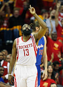 James Harden of the Houston Rockets reacts after scoring against the Los Angeles Clippers during Game Five of the Western Conference Semifinals at...
