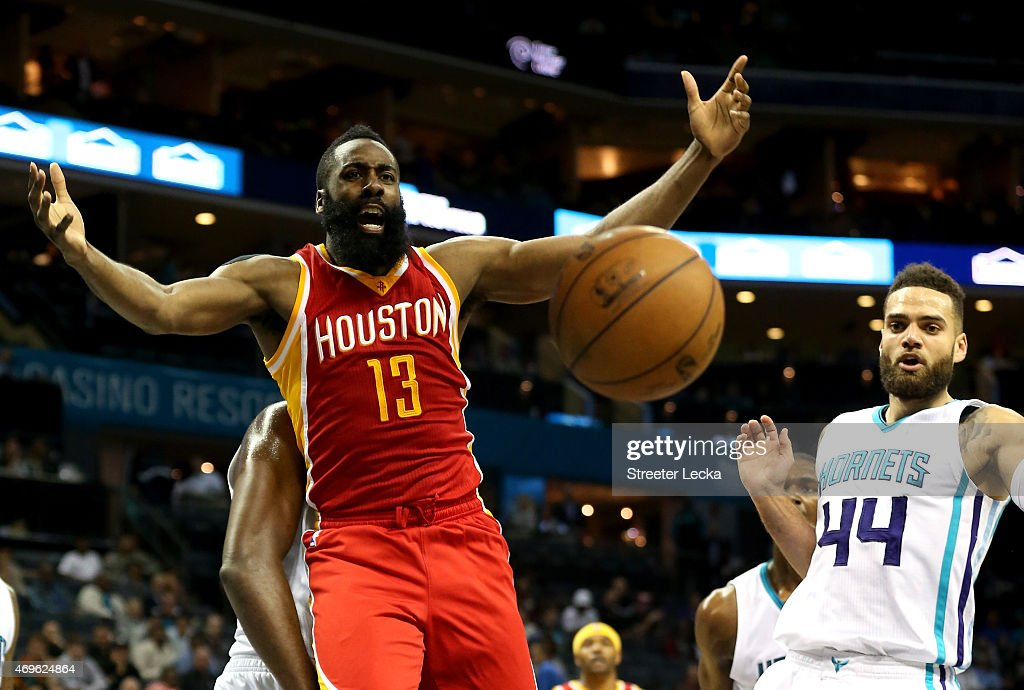 James Harden of the Houston Rockets reacts against Jeff Taylor of the Charlotte Hornets during their game at Time Warner Cable Arena on April 13 2015...