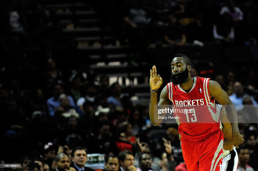 James Harden #13 of the Houston Rockets reacts to a three point shot against the San Antonio Spurs at AT&T Center on December 28, 2012 in San Antonio, Texas.