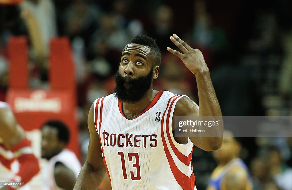 <a gi-track='captionPersonalityLinkClicked' href=/galleries/search?phrase=James+Harden&family=editorial&specificpeople=4215938 ng-click='$event.stopPropagation()'>James Harden</a> #13 of the Houston Rockets reacts to a three-point shot late in the fourth quarter during the game against the Golden State Warriors at Toyota Center on December 6, 2013 in Houston, Texas.