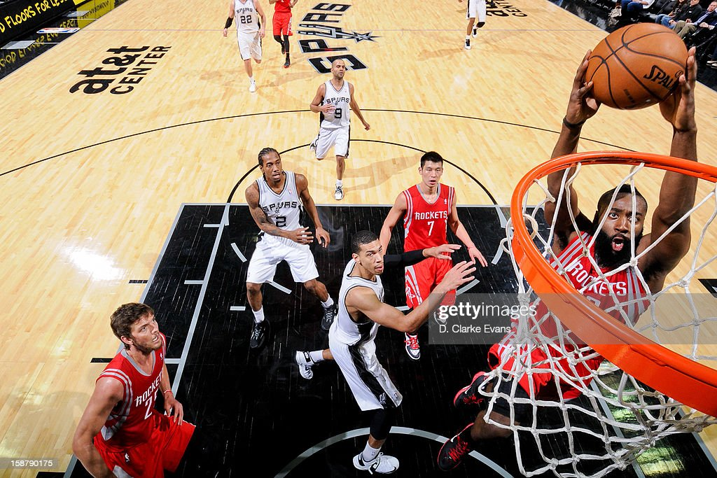 <a gi-track='captionPersonalityLinkClicked' href=/galleries/search?phrase=James+Harden&family=editorial&specificpeople=4215938 ng-click='$event.stopPropagation()'>James Harden</a> #13 of the Houston Rockets rises for a dunk against the San Antonio Spurs on December 28, 2012 at the AT&T Center in San Antonio, Texas.