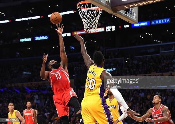 James Harden of the Houston Rockets scores over Julius Randle of the Los Angeles Lakers at Staples Center on October 26 2016 in Los Angeles...