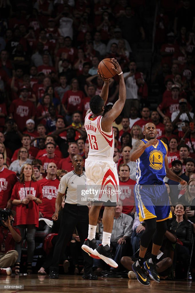 James Harden of the Houston Rockets scores the winning basket against the Golden State Warriors in Game Three of the Western Conference Quarterfinals...