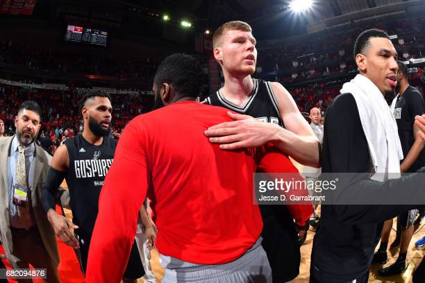 James Harden of the Houston Rockets shares a hug with Davis Bertans of the San Antonio Spurs after the game during Game Six of the Western Conference...