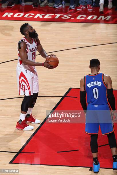 James Harden of the Houston Rockets shoots a foul shot while Russell Westbrook of the Oklahoma City Thunder waits for a rebound in Game Five of the...