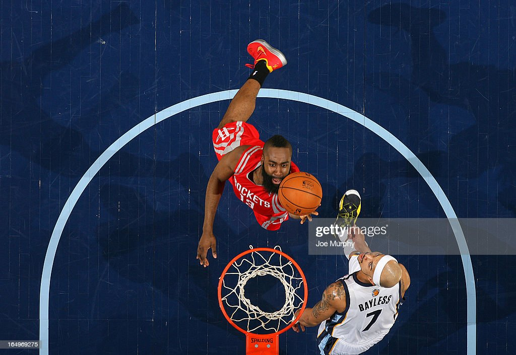 James Harden #13 of the Houston Rockets shoots a layup against Jerryd Bayless #7 of the Memphis Grizzlies on March 29, 2013 at FedExForum in Memphis, Tennessee.