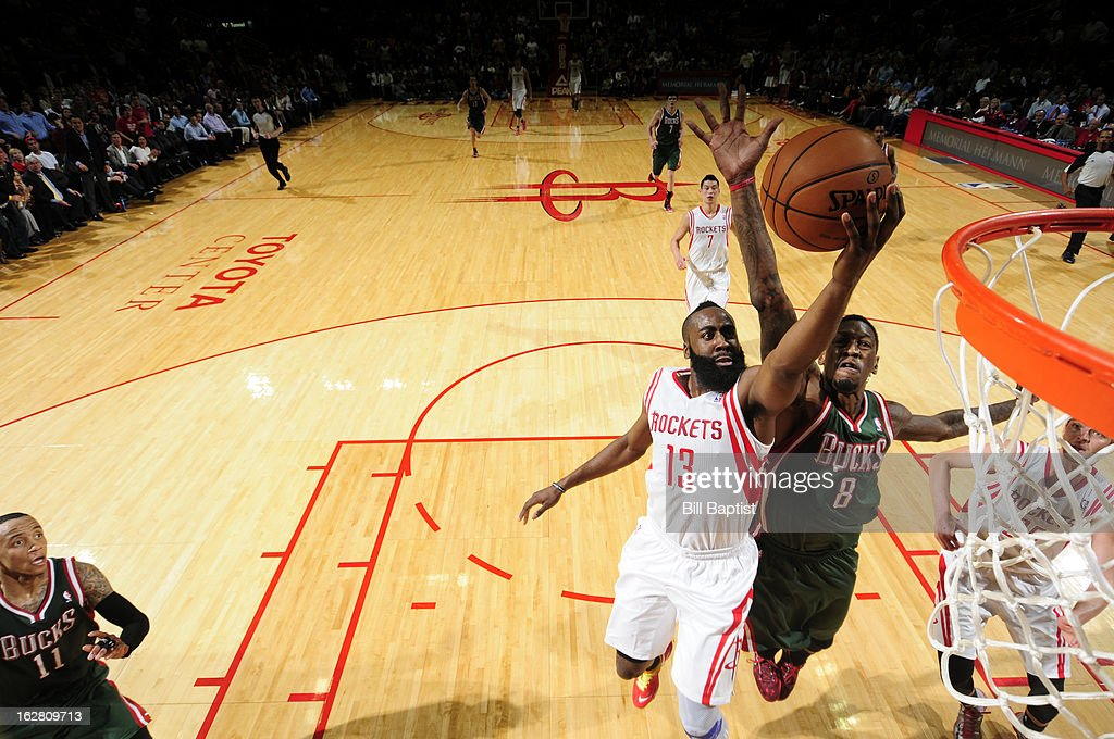 <a gi-track='captionPersonalityLinkClicked' href=/galleries/search?phrase=James+Harden&family=editorial&specificpeople=4215938 ng-click='$event.stopPropagation()'>James Harden</a> #13 of the Houston Rockets shoots a layup against Larry Sanders #8 of the Milwaukee Bucks on February 27, 2013 at the Toyota Center in Houston, Texas.