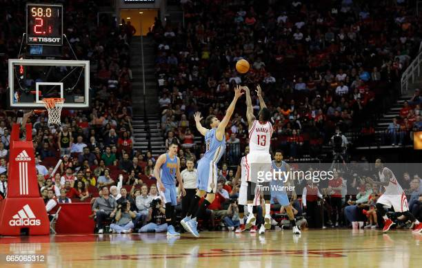 James Harden of the Houston Rockets shoots a threepoint shot defended by Danilo Gallinari of the Denver Nuggets in the second half at Toyota Center...