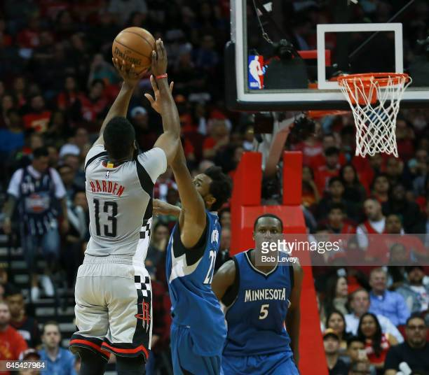 James Harden of the Houston Rockets shoots a threepoint shot over Andrew Wiggins of the Minnesota Timberwolves in the second half at the Toyota...