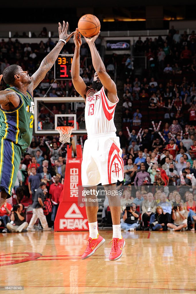 <a gi-track='captionPersonalityLinkClicked' href=/galleries/search?phrase=James+Harden&family=editorial&specificpeople=4215938 ng-click='$event.stopPropagation()'>James Harden</a> #13 of the Houston Rockets shoots a three-pointer against <a gi-track='captionPersonalityLinkClicked' href=/galleries/search?phrase=Marvin+Williams&family=editorial&specificpeople=206784 ng-click='$event.stopPropagation()'>Marvin Williams</a> #2 of the Utah Jazz on March 20, 2013 at the Toyota Center in Houston, Texas.