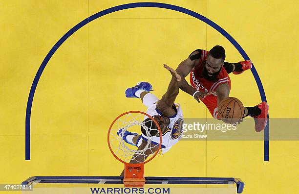 James Harden of the Houston Rockets shoots against Festus Ezeli of the Golden State Warriors in the second half during Game One of the Western...
