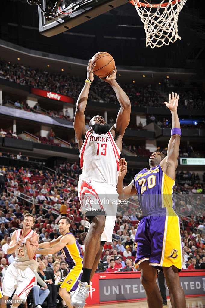 James Harden #13 of the Houston Rockets shoots against Jodie Meeks #20 of the Los Angeles Lakers on January 8, 2013 at the Toyota Center in Houston, Texas.