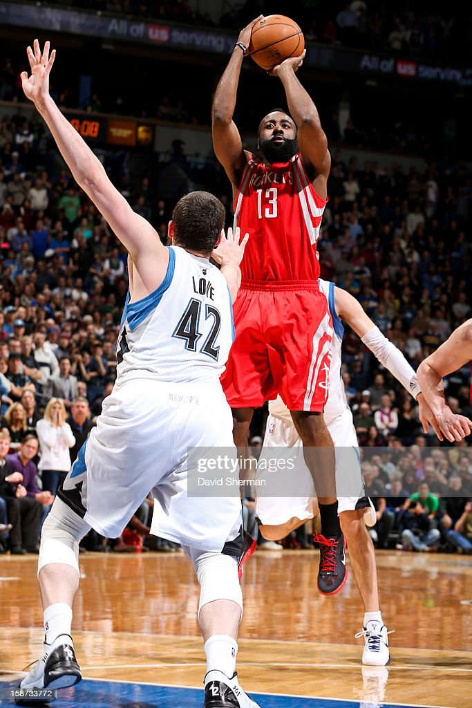 James Harden #13 of the Houston Rockets shoots against Kevin Love #42 of the Minnesota Timberwolves on December 26, 2012 at Target Center in Minneapolis, Minnesota.