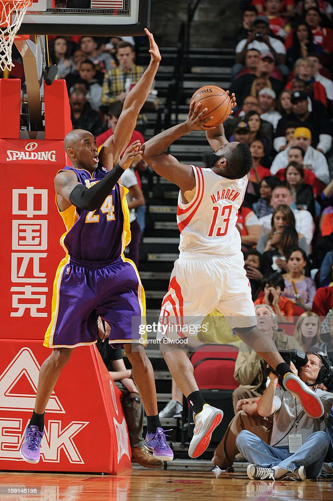 James Harden #13 of the Houston Rockets shoots against Kobe Bryant #24 of the Los Angeles Lakers on January 8, 2013 at the Toyota Center in Houston, Texas.
