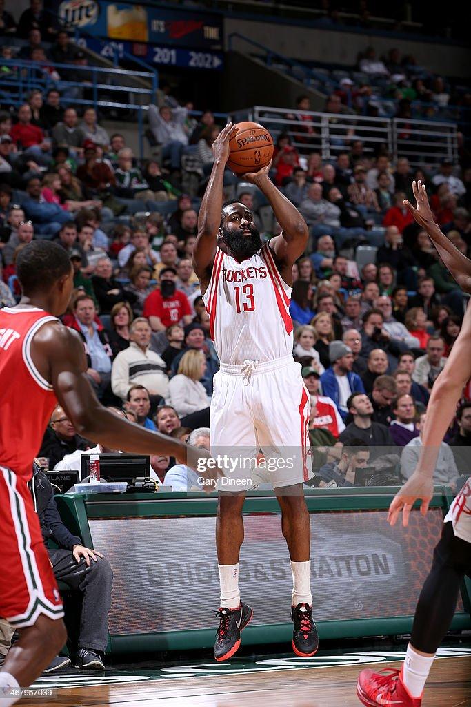 James Harden #13 of the Houston Rockets shoots against the Milwaukee Bucks on February 8, 2014 at the BMO Harris Bradley Center in Milwaukee, Wisconsin.