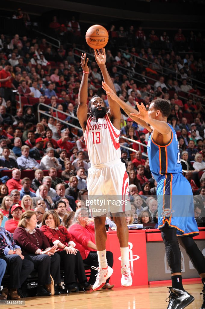 James Harden #13 of the Houston Rockets shoots against the Oklahoma City Thunder on January 16, 2014 at the Toyota Center in Houston, Texas.