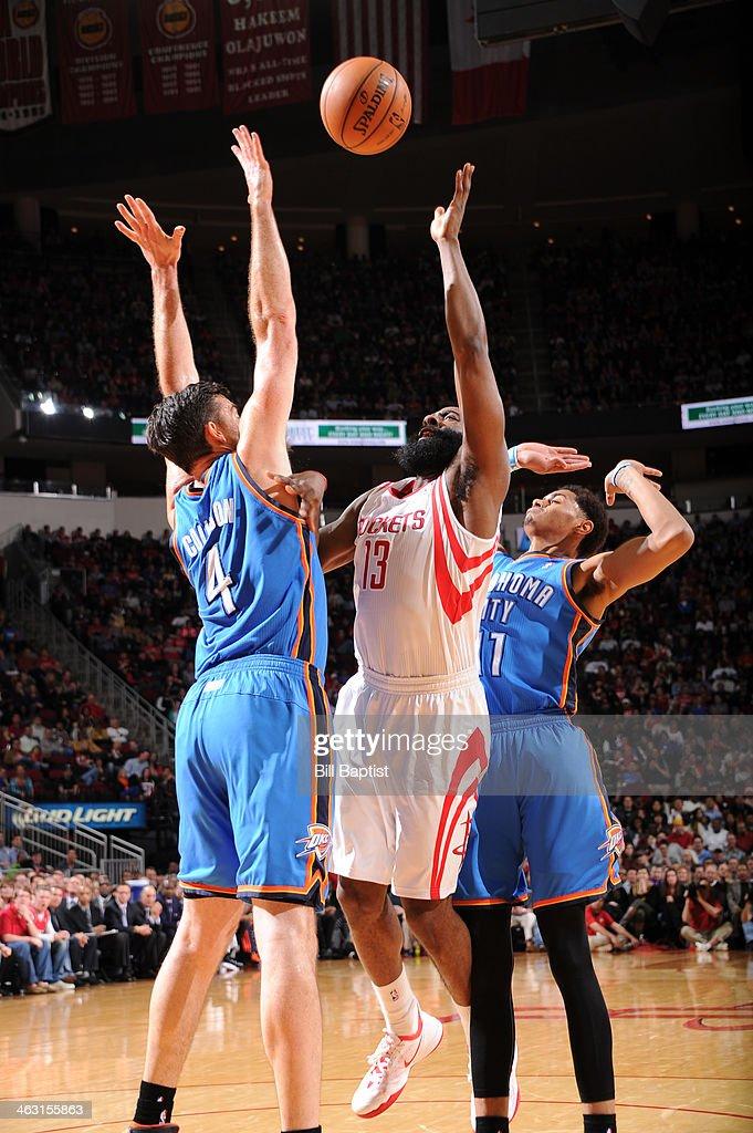 James Harden #13 of the Houston Rockets shoots against the Oklahoma City Thunder on January 16, 2014 at the Toyota Center in Houston, Texas.