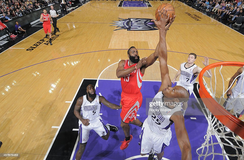 <a gi-track='captionPersonalityLinkClicked' href=/galleries/search?phrase=James+Harden&family=editorial&specificpeople=4215938 ng-click='$event.stopPropagation()'>James Harden</a> #13 of the Houston Rockets shoots against <a gi-track='captionPersonalityLinkClicked' href=/galleries/search?phrase=Travis+Outlaw&family=editorial&specificpeople=203322 ng-click='$event.stopPropagation()'>Travis Outlaw</a> #25 of the Sacramento Kings on December 15, 2013 at Sleep Train Arena in Sacramento, California.